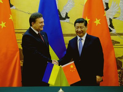 Ukrainian President Viktor Yanukovych, left, shakes hands with Chinese President Xi Jinping, right, during a signing ceremony at the Great Hall of the People in Beijing Thursday, Dec. 5, 2013. Yanukovych's visit aimed to gain Chinese support for Ukraine's battered economy. The country's economic malaise has helped fuel ongoing massive anti-government protests in the capital, Kiev, demanding the government's resignation. (AP Photo/Wang Zhao, Pool)