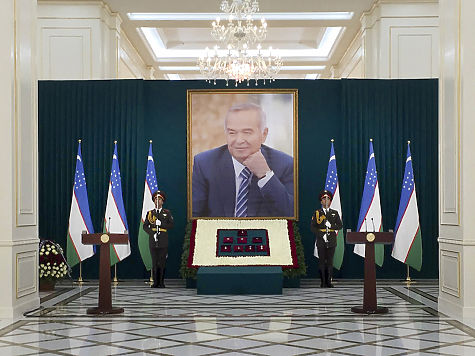 In this photo released by Kyrgyz Government Press Service, Uzbekistan honor guards stand next to a large portrait of the late President Islam Karimov and his awards in Samarkand, Uzbekistan, early Saturday, Sept. 3, 2016. Karimov, whose harsh and ill-tempered rule governed Uzbekistan for a quarter-century, is to be buried in his home city of Samarkand. (Kyrgyz Government Press Service via AP)