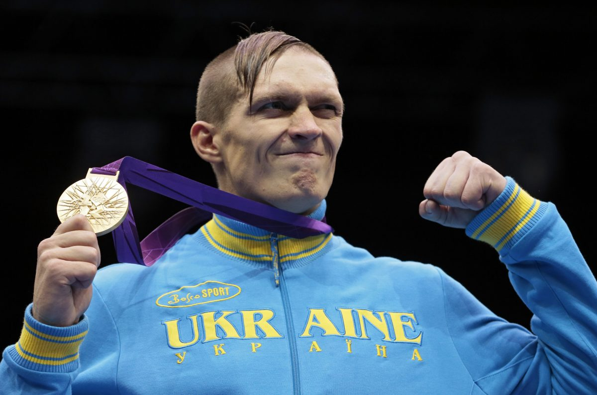 Ukraine's Oleksandr Usyk holds his gold medal after winning the men's heavyweight 91-kg boxing competition at the 2012 Summer Olympics, Saturday, Aug. 11, 2012, in London. (AP Photo/Ivan Sekretarev)